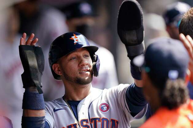 Houston Astros' Yuli Gurriel is congratulated after scoring in the 10th inning of a baseball game against the Cleveland Indians, Sunday, July 4, 2021, in Cleveland. (AP Photo/Tony Dejak) Photo: Tony Dejak, Associated Press / Copyright 2021 The Associated Press. All rights reserved.