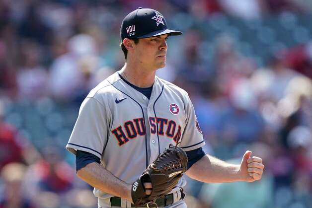 Houston Astros relief pitcher Brooks Raley pumps his fist after his team defeated the Cleveland Indian in 10 innings of a baseball game, Sunday, July 4, 2021, in Cleveland. (AP Photo/Tony Dejak) Photo: Tony Dejak, Associated Press / Copyright 2021 The Associated Press. All rights reserved.