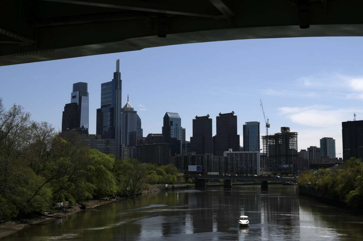 A boat with fishermen floats on the Schuylkill River, with the Center City Philadelphia, PA skyline in the background on April 28, 2020. Despite the state-wide stay-at-home order still in effect, spring weather draws hundreds to exercise outdoors. (Photo by Bastiaan Slabbers/NurPhoto via Getty Images)