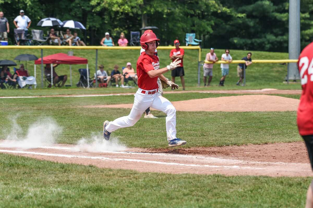 Berryhill's Danny Witbeck scurries to first during Sunday's Adams Bracket final against the Capital City Kings in the Gabby Mills July Fourth Invitational at Northwood.