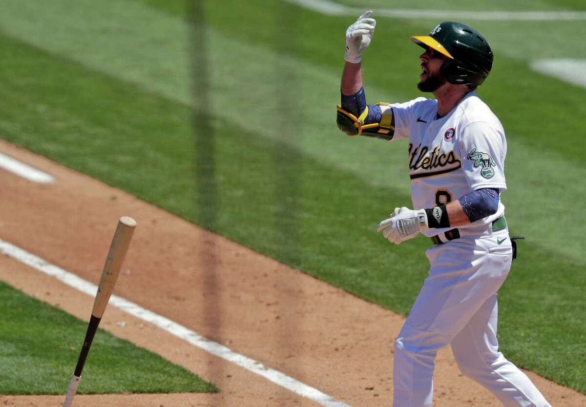 Jed Lowrie (8) reacts to being called out on strikes in the fourth inning as the Oakland Athletics played the Boston Red Sox at the Coliseum in Oakland, Calif., on Sunday, July 4, 2021.