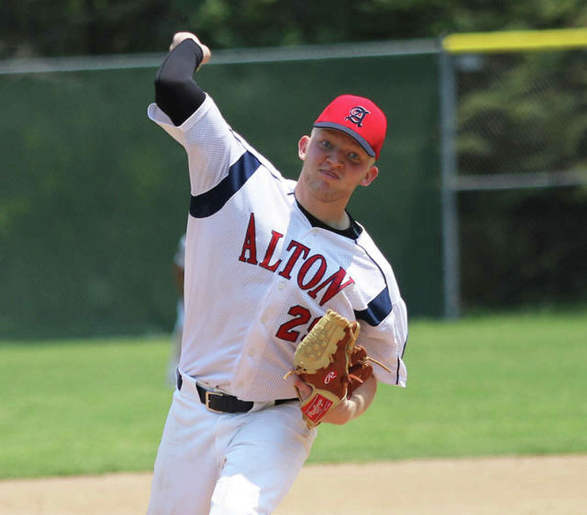Alton Legion's Brady Salzman, a Southwestern High graduate, delivers a pitch Sunday against Highland at Moody Park in Fairview Heights.