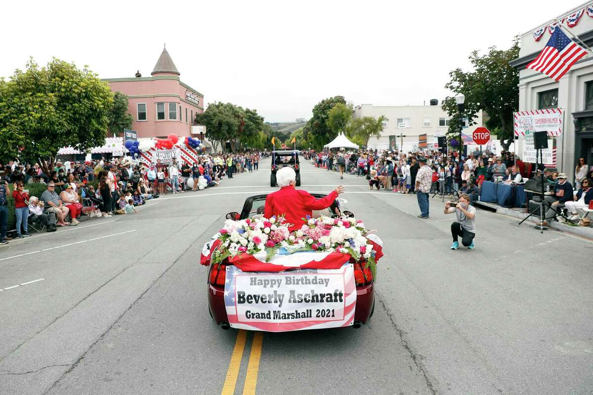 Grand Marshall Beverly Aschrath rides in the Half Moon Bay Ol'Fashioned 4th of July Parade.