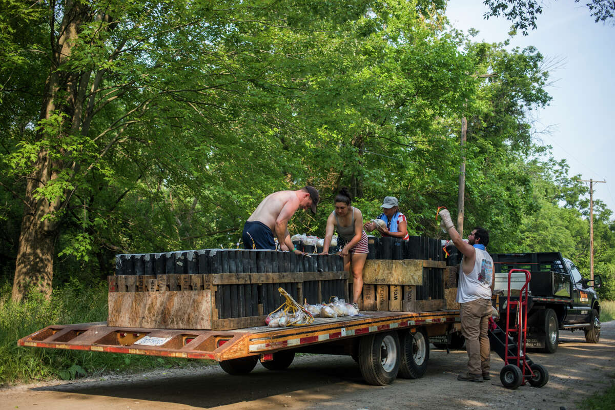Workers with Wolverine Fireworks Display Inc. set up hundreds of fireworks ahead of the Midland fireworks display Sunday, July 4, 2021 at St. Charles Park. (Katy Kildee/kkildee@mdn.net)