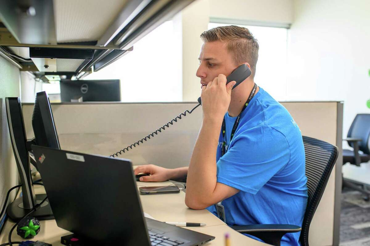 Justin Thorton calls clients at the Benefit center at Houston Food Bank on Friday, July 2, 2021