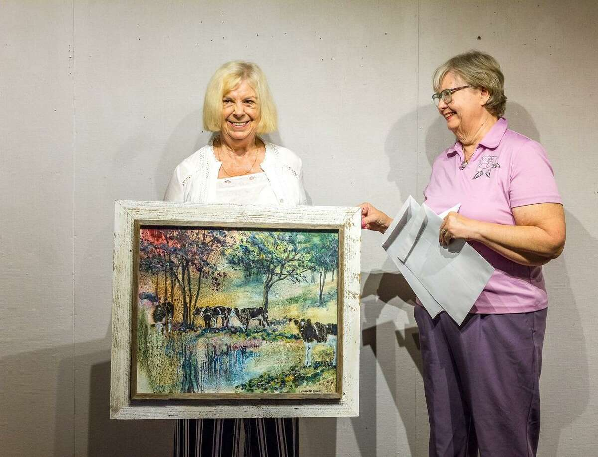 """The Kent Art Association has announced its awards for its selected 2021 President's Show, which began, June 20, with a date of conclusion, July 25. Sue Lapardo, KAA President, presenting Judith Beringer Hraniotis the Award for Excellence for her oil painting """"Storm Watch."""""""