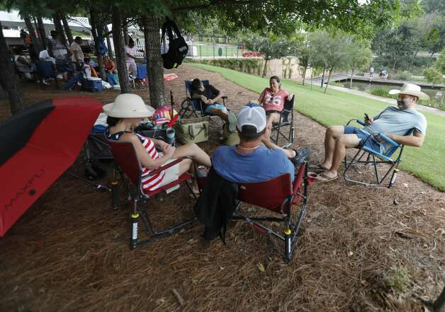 Residents stake out shaded areas to enjoy evening fireworks during The Woodlands Township's Red, Hot & Blue Festival at Town Green Park, Sunday, July 4, 2021, in The Woodlands. Photo: Jason Fochtman/Staff Photographer / ? 2021 Houston Chronicle