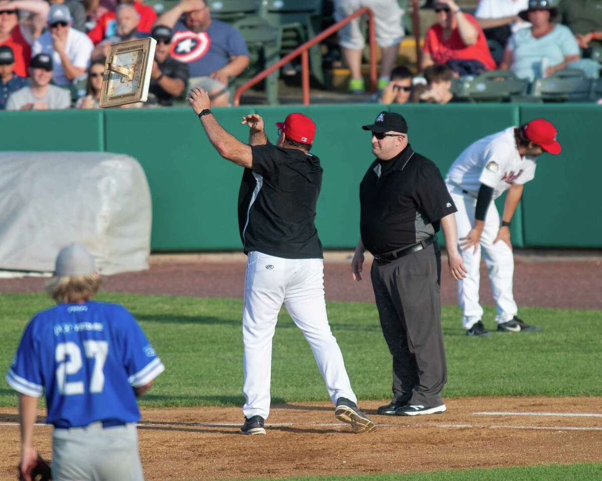 Tri-City ValleyCats manager Pete Incaviglia tosses first base towards left field after getting thrown out of the game for arguing with first base umpire James Grillo after the ump called Willy Garcia out at first base at the Joseph L. Bruno Stadium on the Hudson Valley Community College in Troy, NY, on Sunday, July 4, 2021. (Jim Franco/Special to the Times Union)