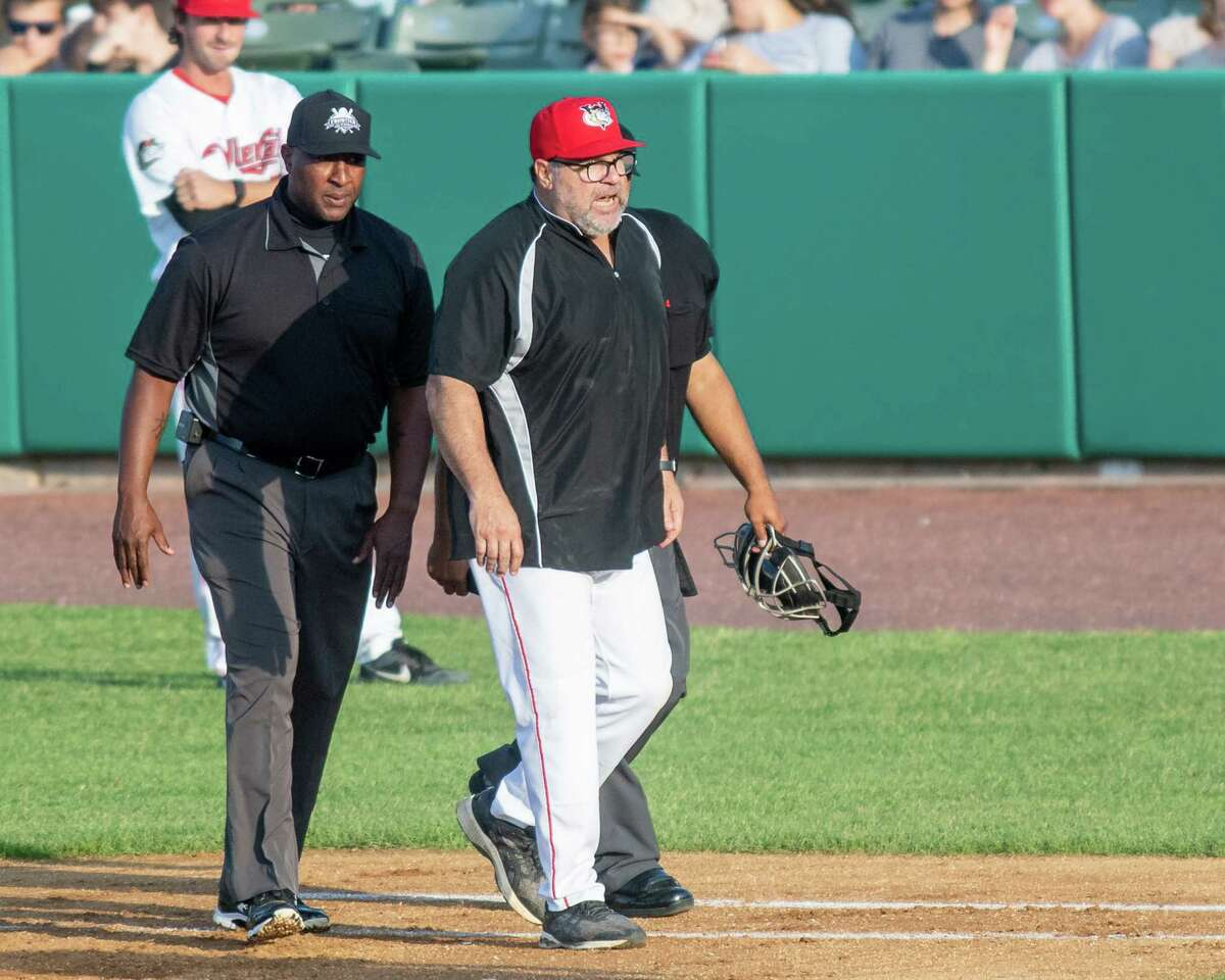 Tri-City ValleyCats manager Pete Incaviglia is escorted off the field by home plate umpire Michael Herring after getting thrown out of the game for arguing with first base umpire James Grillo after the ump called Willy Garcia out at first base at the Joseph L. Bruno Stadium on the Hudson Valley Community College in Troy, NY, on Sunday, July 4, 2021. (Jim Franco/Special to the Times Union)