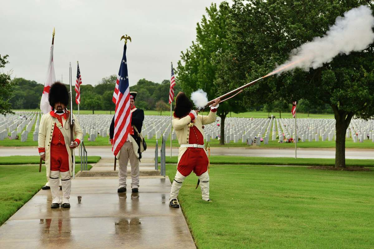 """A """"shot heard 'round the world"""" begins the Order of Granaderos y Damas de Galvez 4th of July Patriotic Ceremony Sunday morning at Fort Sam Houston National Cemetery."""