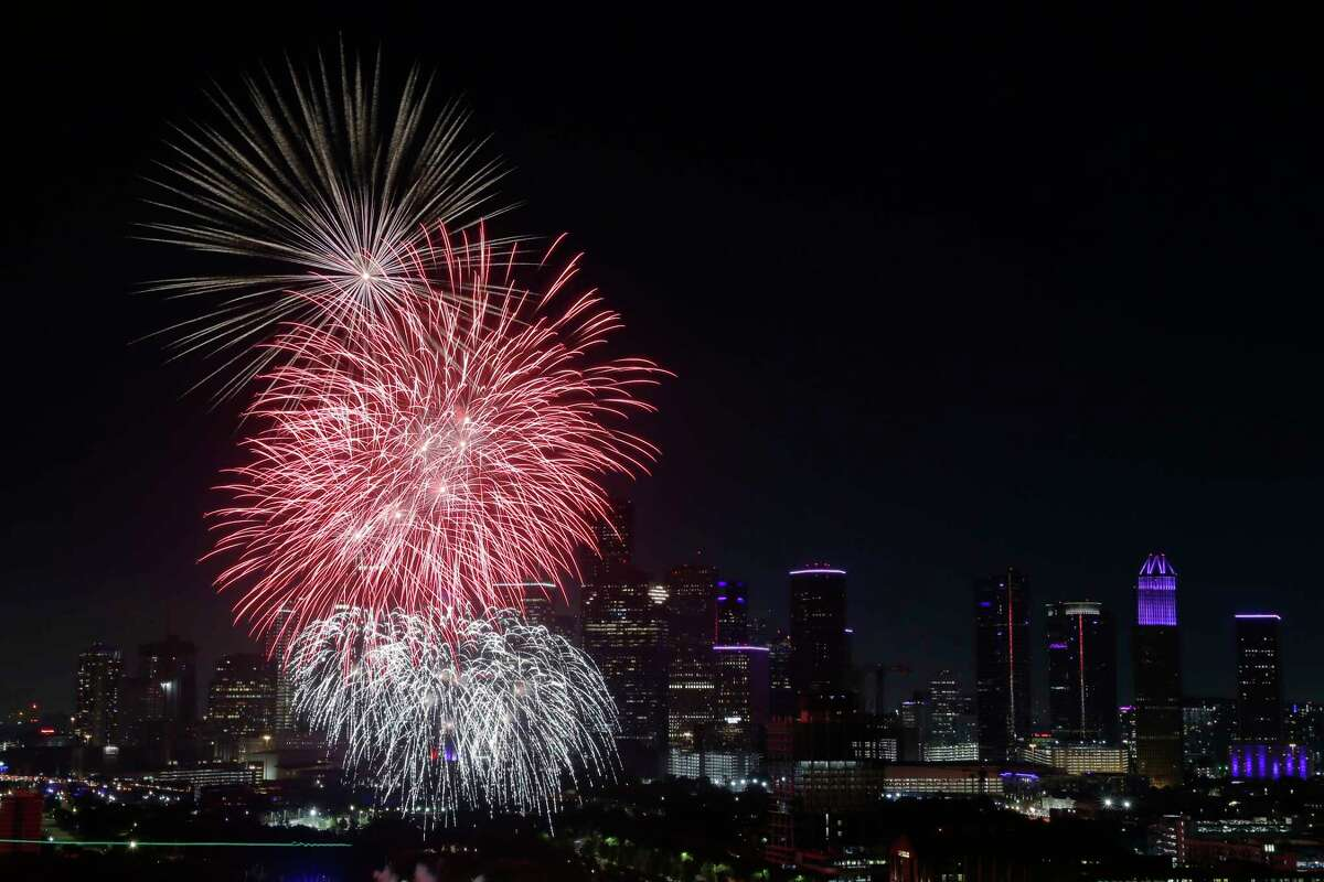 Fireworks fly over the skyline as seen from the 25th floor penthouse of the Windsor Memorial during the annual fireworks display Sunday, July 4, 2021 in Houston, TX.