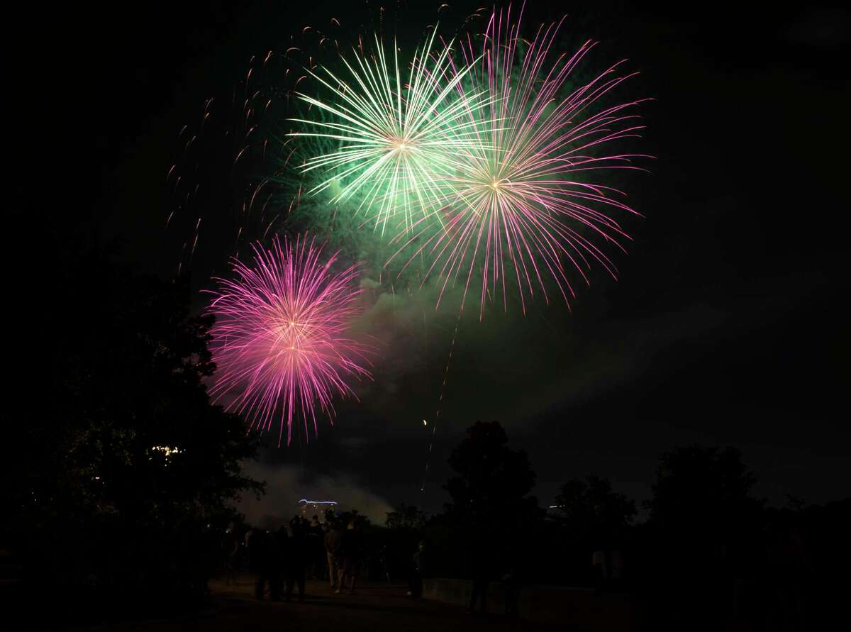 The 2021 Shell Freedom Over Texas fireworks show goes off on Buffalo Bayou Sunday, July 4, 2021, from Eleanor Tinsley Park in Houston. While the concert is still virtual this year, people were allowed to be at the park to watch the fireworks.