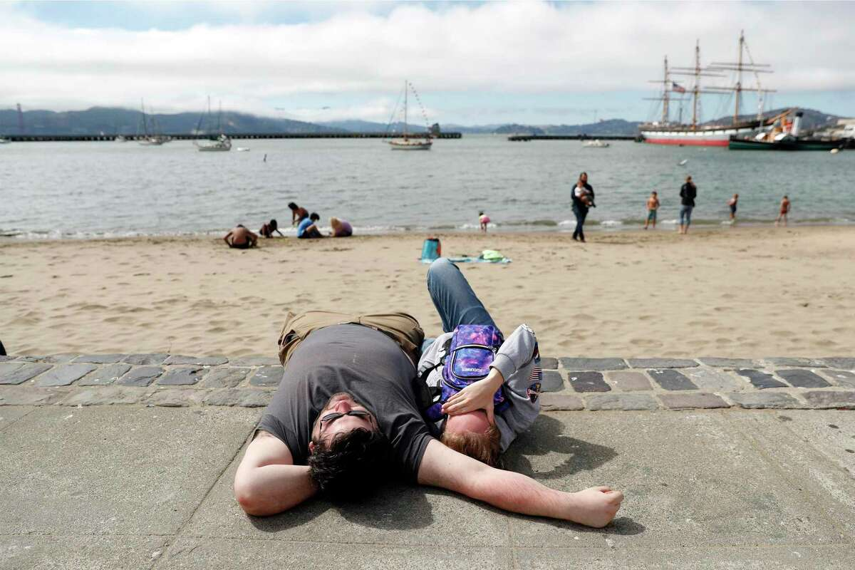 Mike Randolph and Sam Simao relax at Aquatic Park in San Francisco ahead of the city's waterfront fireworks show.