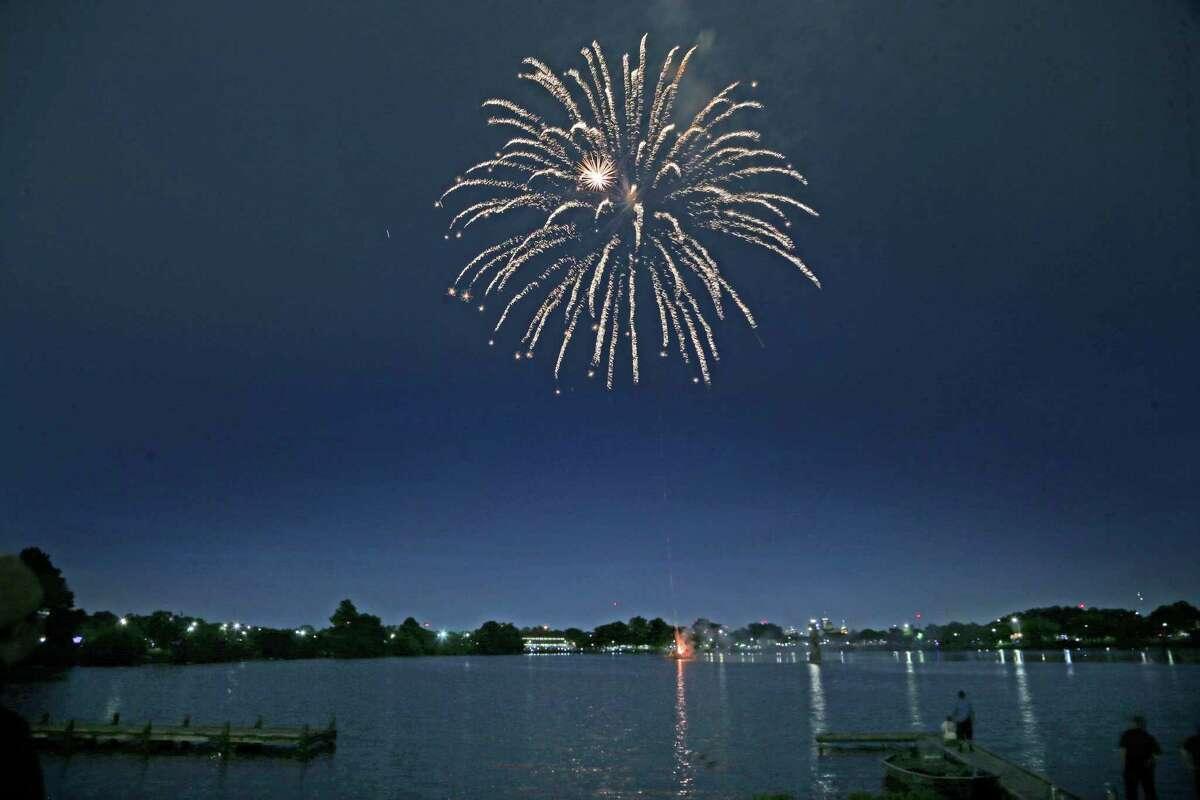 Fireworks on Woodlawn lake on Sunday, July 4, 2021 at Woodlawn Lake Park.