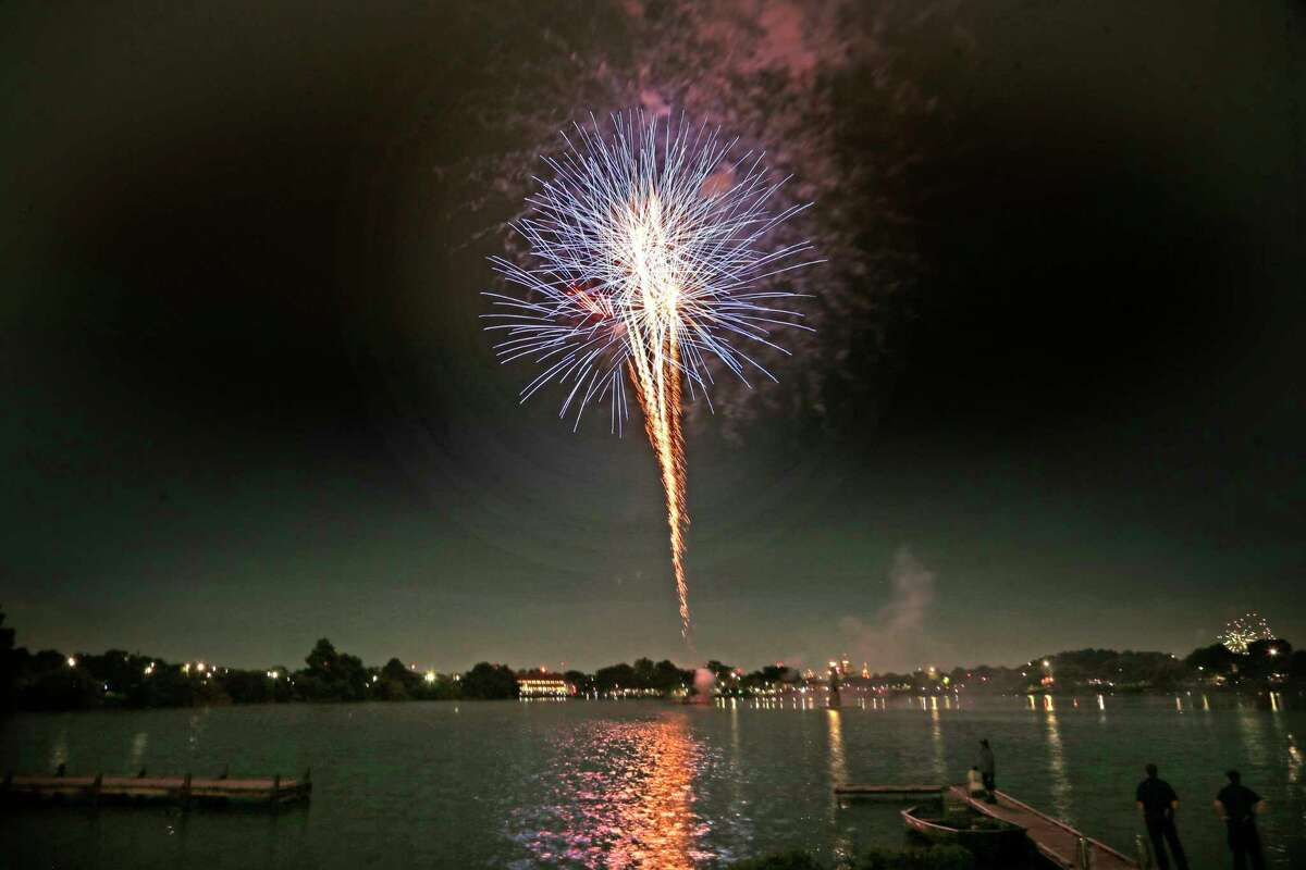 Fireworks over the Woodlawn lake on Sunday, July 4, 2021 at Woodlawn Lake Park.