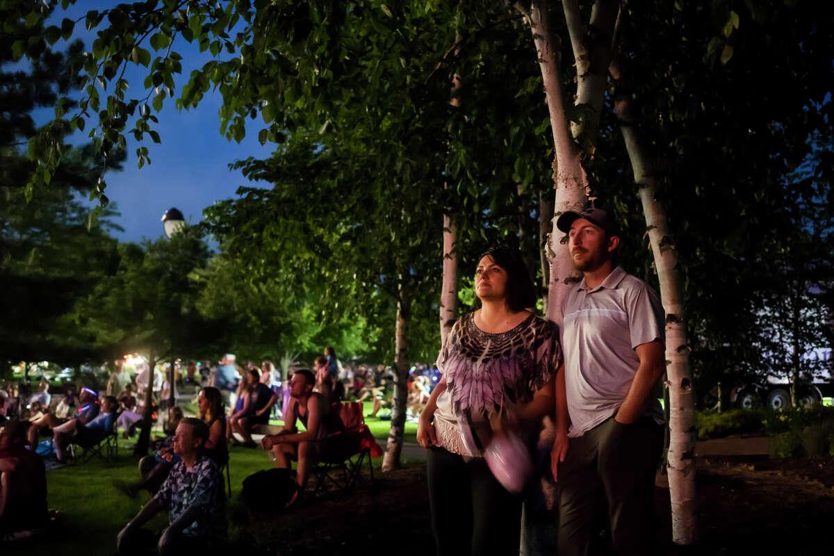 Chris and Tania Dossey watch a fireworks display Monday, July 4, 2021 at Dow Diamond in Midland. (Katy Kildee/kkildee@mdn.net)