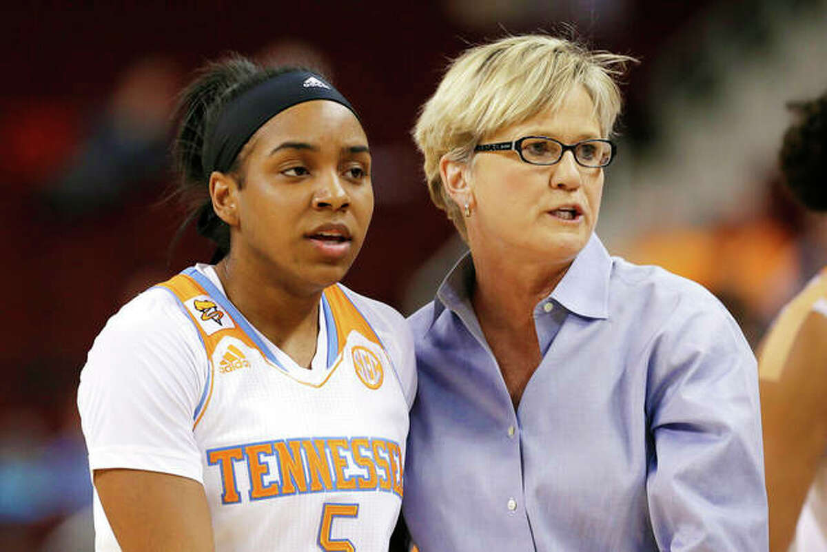 In this March 6, 2015, file photo, Tennessee coach Holly Warlick, right, talks with Ariel Massengale (5) in the first half of a Southeastern Conference women's tournament NCAA college quarterfinal basketball game against Georgia in North Little Rock, Ark.