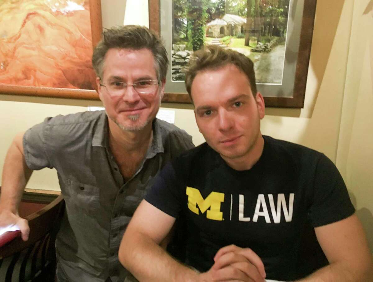 Bret Cousineau, left, owner of Espresso Milano, visited with Joe Blackhurst when Joe was on break from law school at the University of Michigan. Joe spent the summer of 2017 working at Milano. (Photo by Niky House)