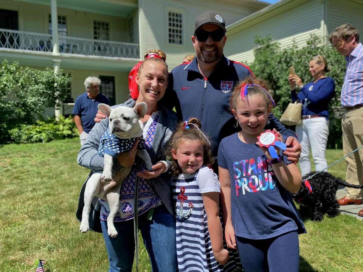 A family poses at the Litchfield Historical Society's annual pet parade on Sunday.