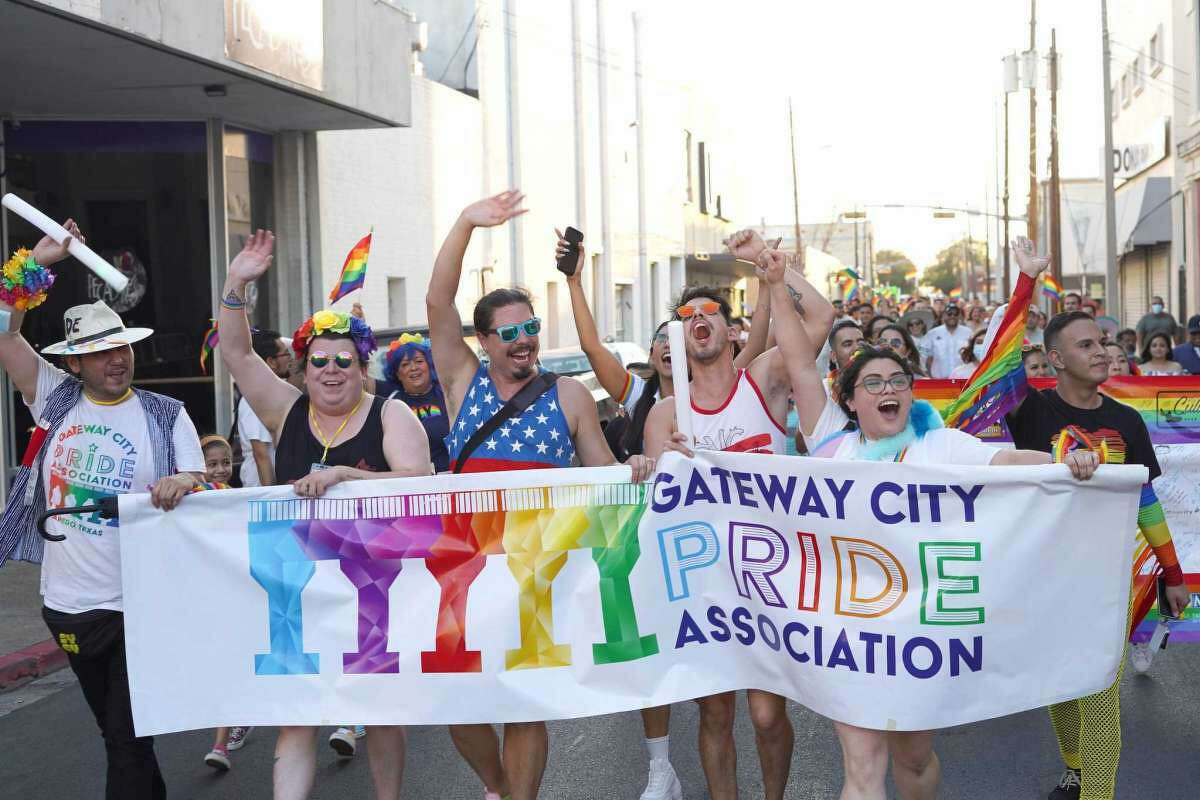 Gateway City Pride Association team members including president Jorge Quijano, third from left, lead the Pride Parade on Iturbide Street on June 26.