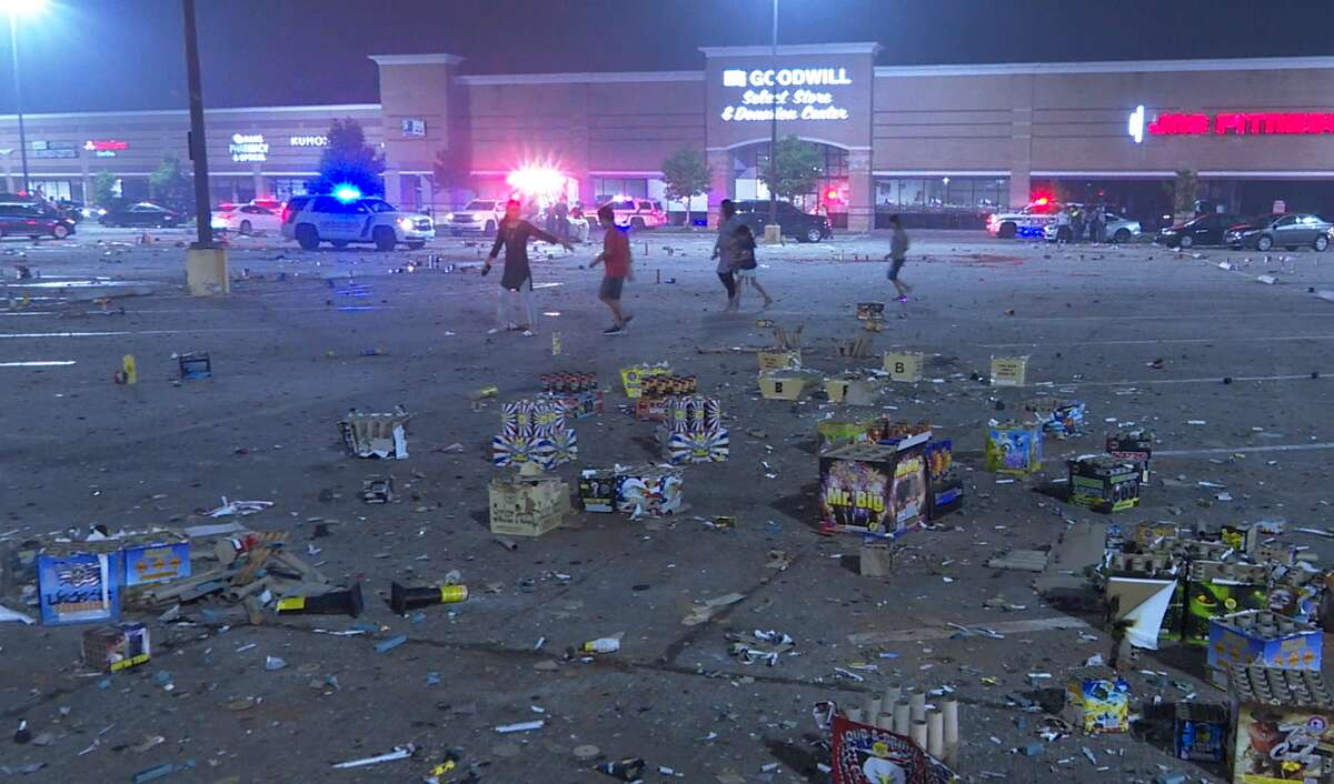 Discarded fireworks can be seen in a parking lot in the 11500 block of Texas Highway 6 after a woman was injured.