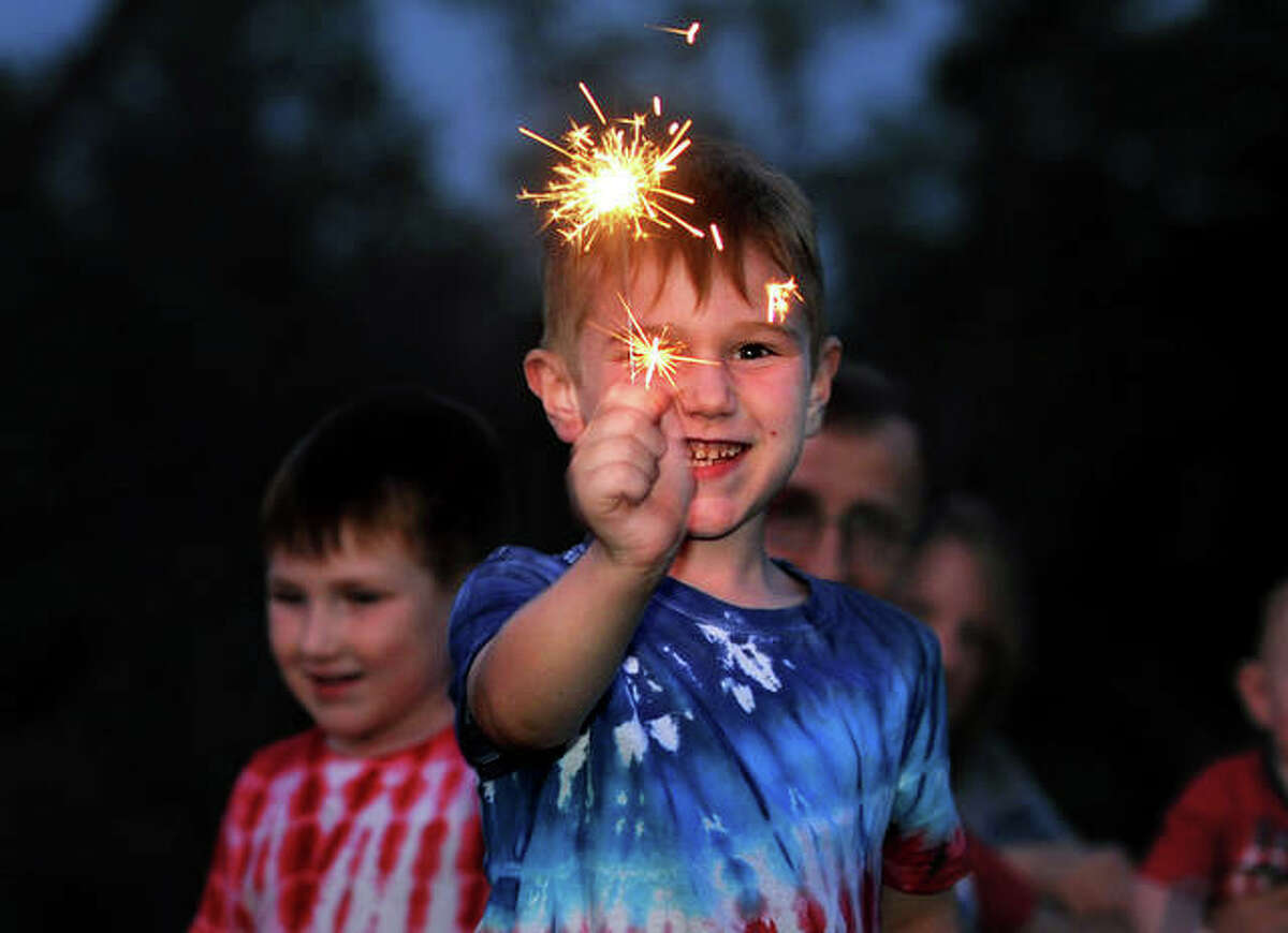 Aiden McCoy, 6, of Edwardsville plays with a sparkler during the Edwardsville Independence Day Celebration Saturday at American Legion Post 199.