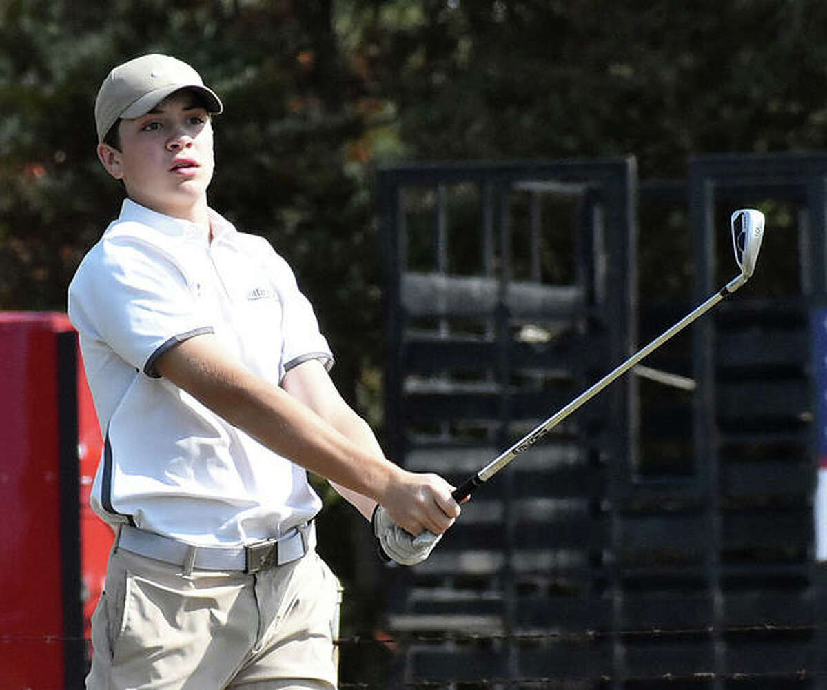 Father McGivney's Joey Hyten watches his tee shot on No. 9 at Timber Lakes Golf Course in Staunton during the Class 1A Mount Olive Regional.