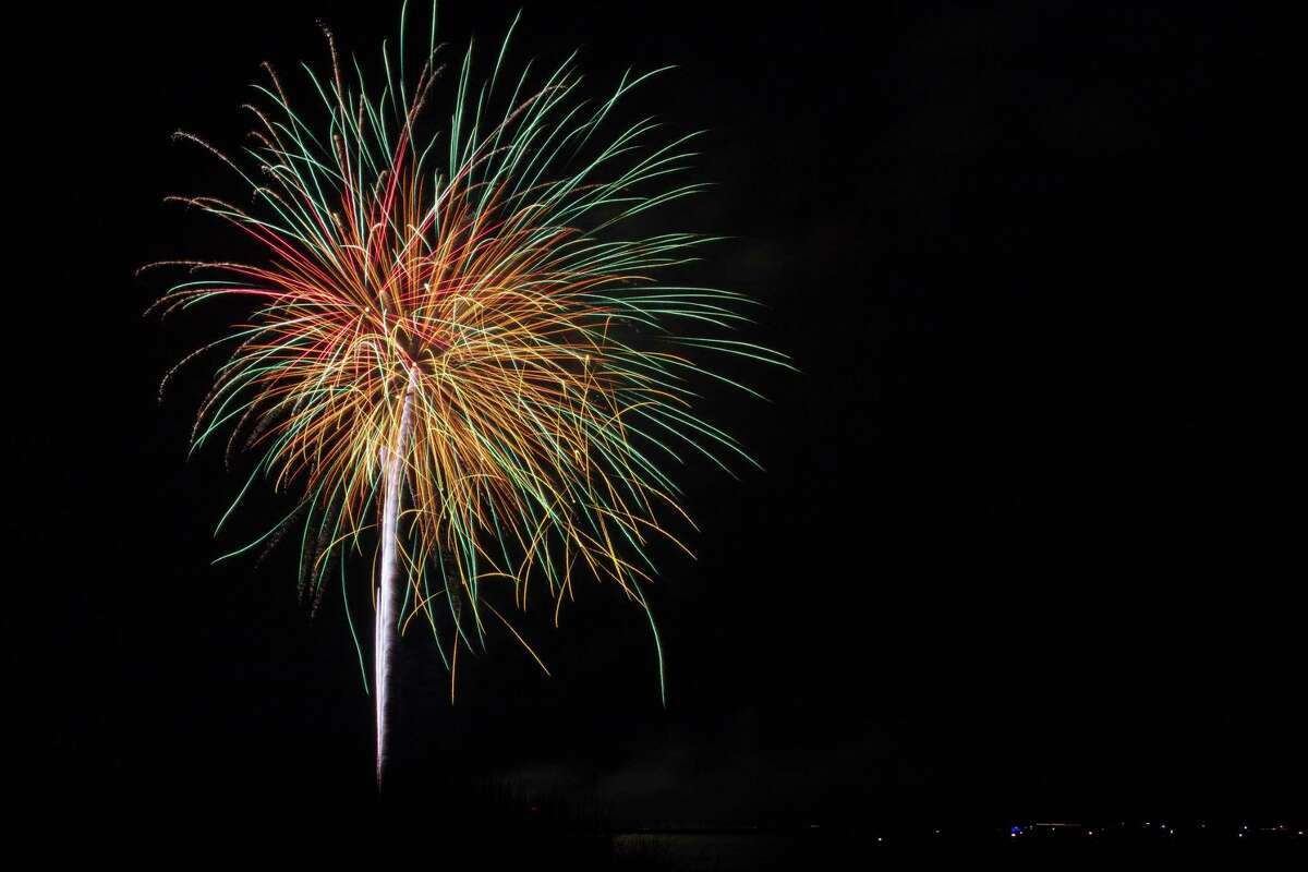 Manistee resident Tom Voss captured the fireworks near near the Manistee River Channel with boats anchored in Lake Michigan. The fireworks display was part of the Manistee Natonal Forest Festival. (Courtesy photo/Tom Voss)