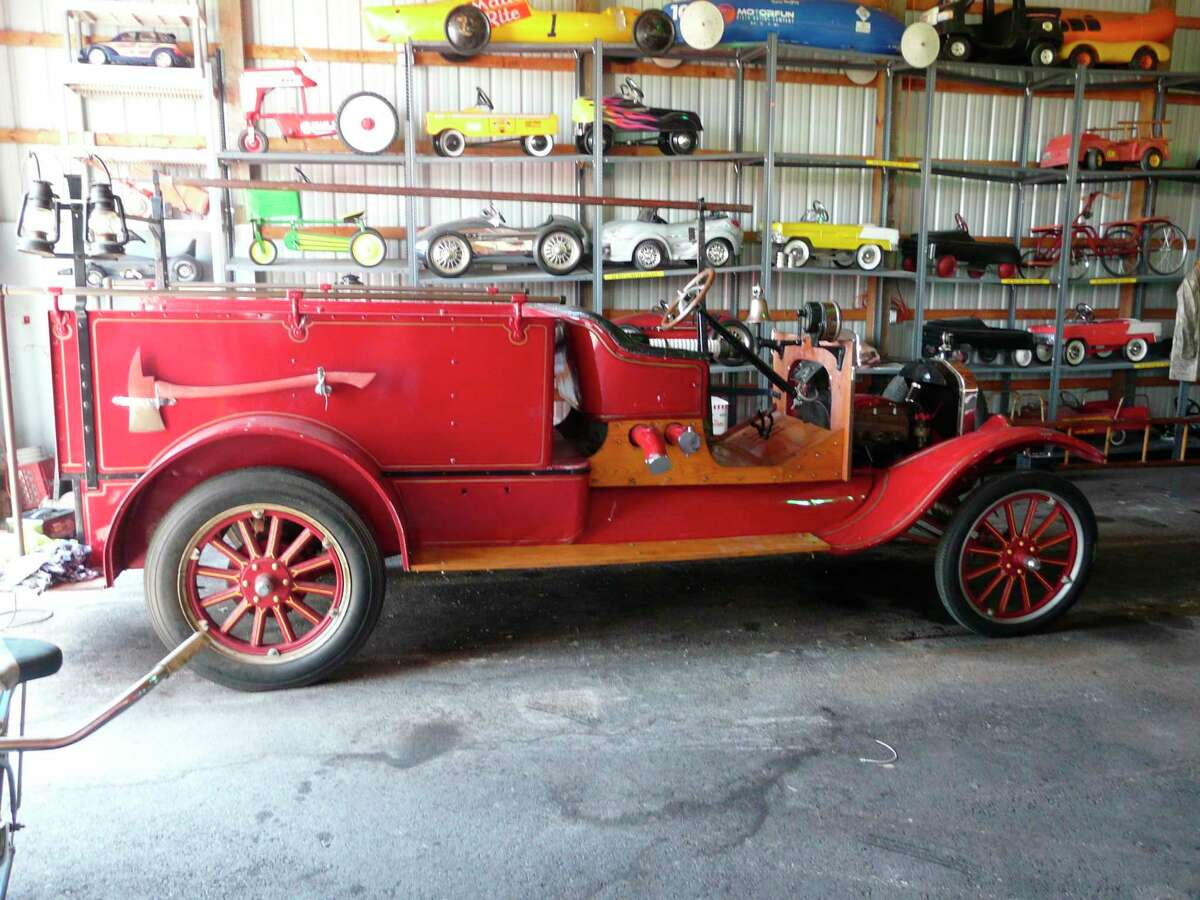 This 1922 Ford Model T Pumper is one of the vintage fire engines that will be part of the Auburn Cornfest Parade on Sunday, July 11. More than 60 other classic fire engines are part of the Bay City Antique Toy & Fire Museum, a nonprofit dedicated to preserving American public safety history. The museum also is home to more than 12,000 antique and collectible toys, many of them fire, police and rescue vehicles. (Photo by Jon Becker/for the Daily News)