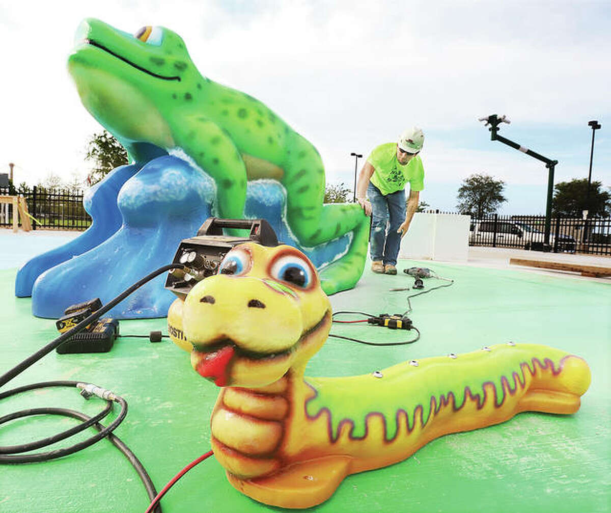 Colorful animals are waiting to make a big splash with younger children when the Alton splash pad is completed this summer.