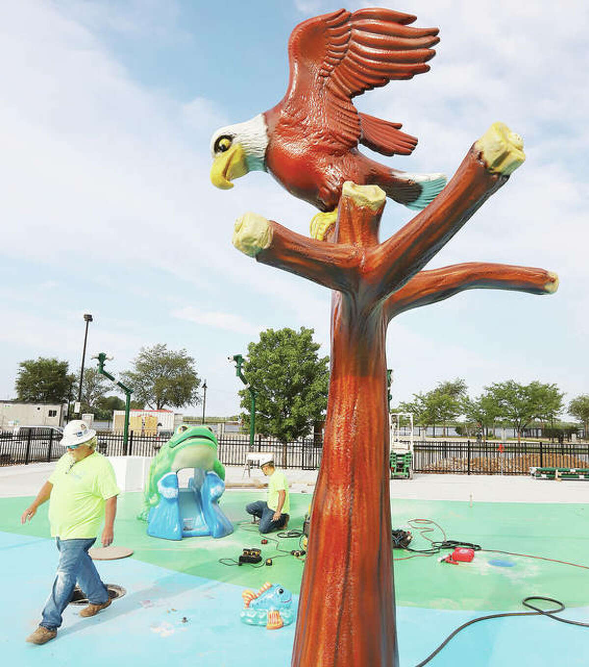 Workers of Friday were installing the plastic water sprayers at Alton's new splash pad in Riverfront Park. The pad has two bald eagles, a frog, a steamboat and other smaller animals - all of which will shoot out water when the pad is completed later this summer.