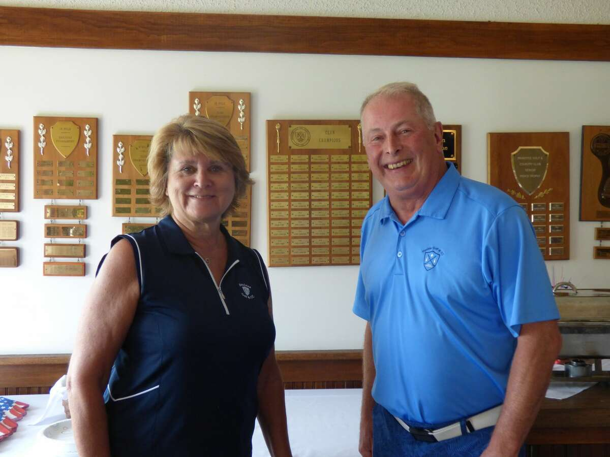 Manistee Golf and Country Club board members, Mary Lou Racine and Ray Latham oversee celebrations for the club's 120th anniversary Saturday.