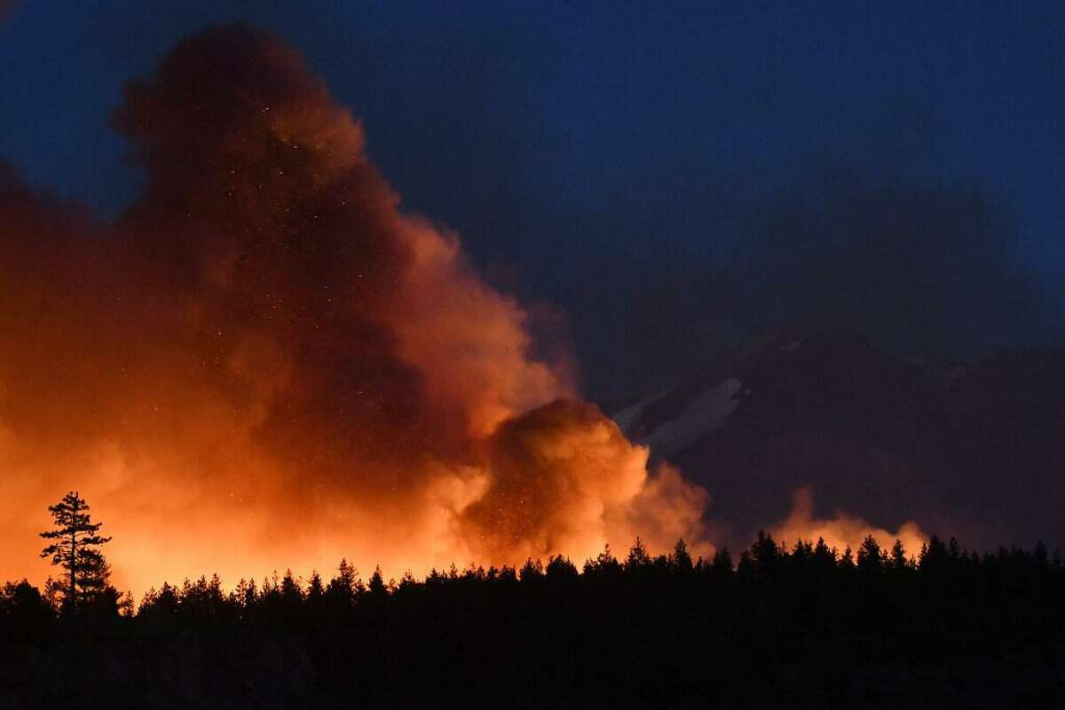 Cal Fire crews work to extinguish hot spots during the Lava Fire near Weed (Siskiyou County) last month.