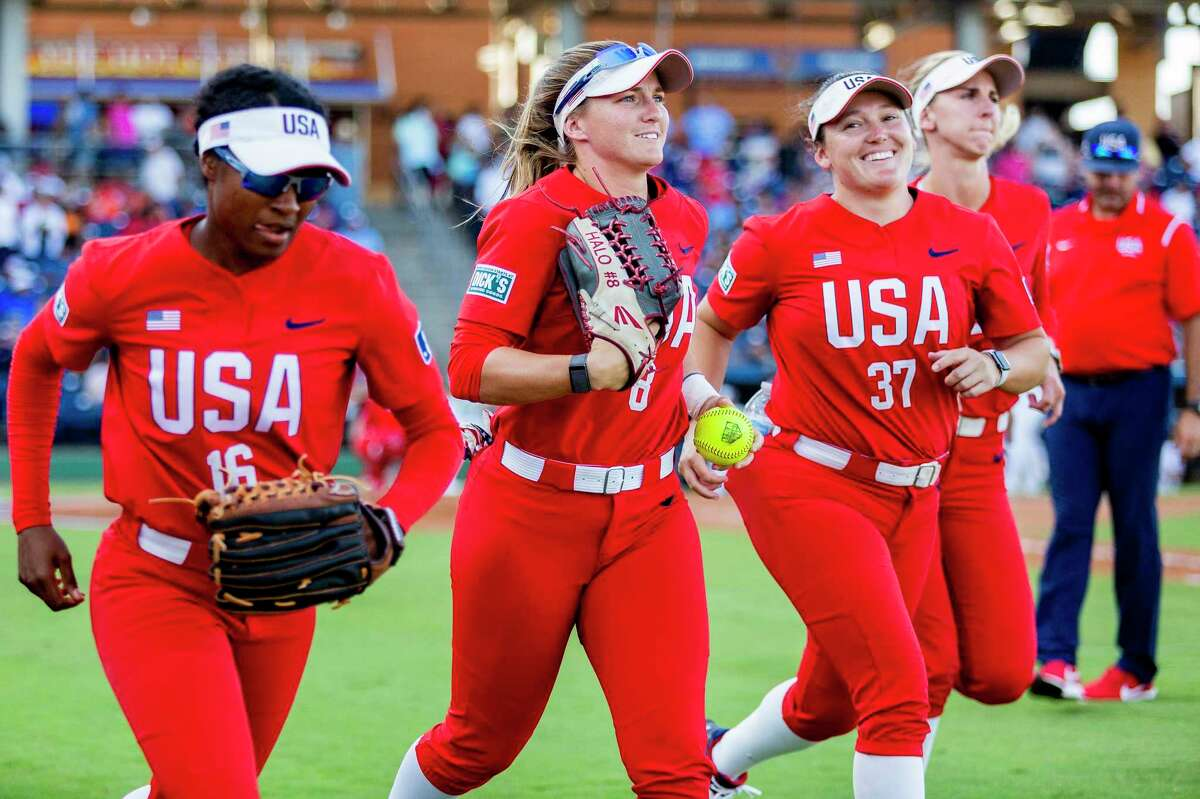 United States' Haylie McCleney (8) heads out to the outfield with her teammates before the start of an inning against Team Alliance at Momentum Bank Ballpark Saturday, June 12, 2021, in Midland, Texas. (Jacob Ford/Odessa American via AP)