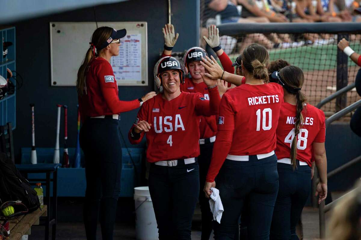 United States' Amanda Chidester (4) is congratulated by teammates after scoring in the first game of the team's doubleheader against Team Alliance, made up of college players from around the country, Friday, June 11, 2021, in Midland, Texas. (Eli Hartman/Odessa American via AP)