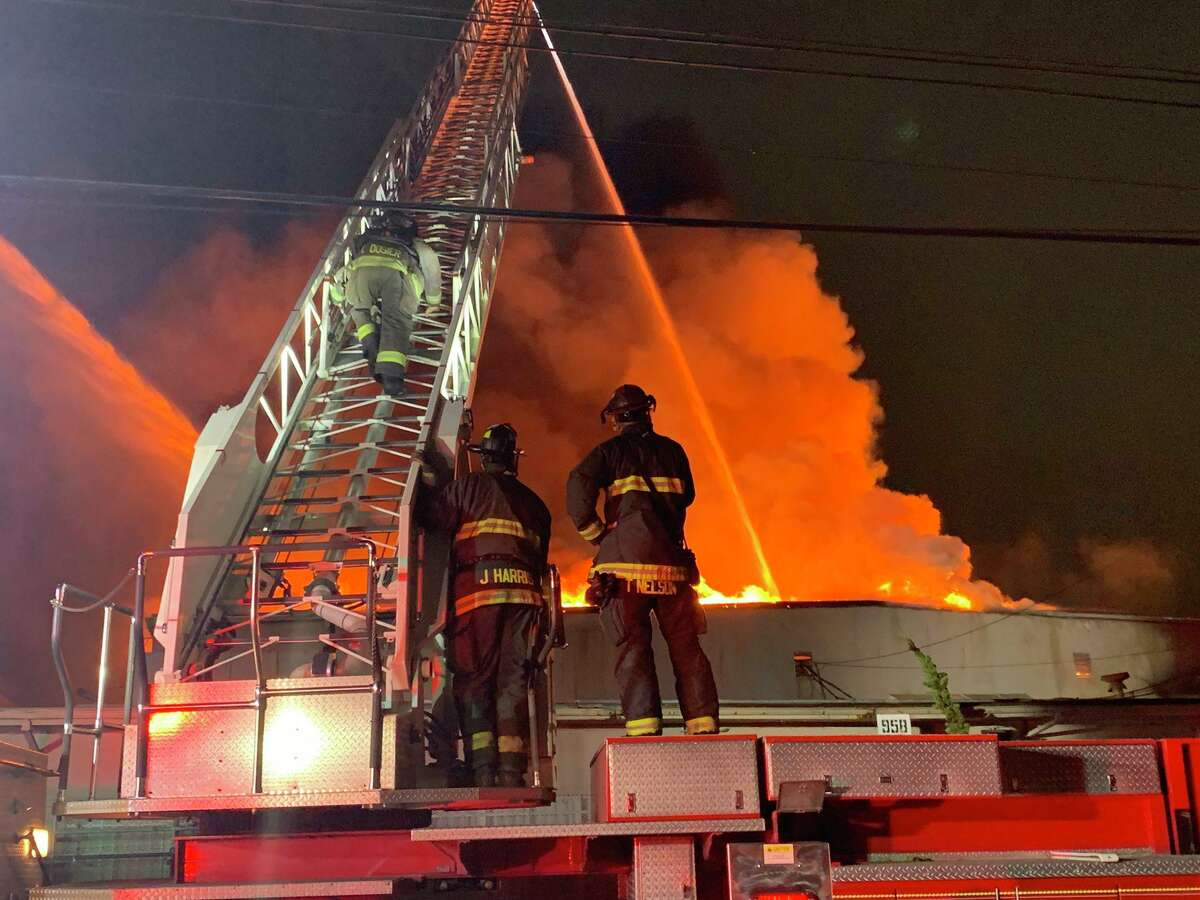 Firefighters battle a blaze at a warehouse at the 900 block of 77th Avenue in East Oakland.
