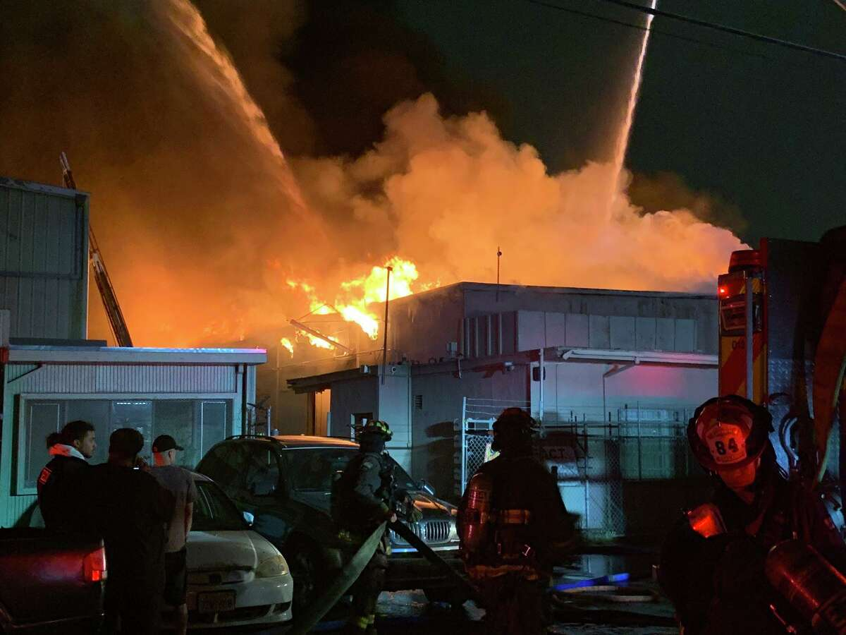 Oakland firefighters battle a warehouse blaze on the 900 block of 77th Avenue in East Oakland on Sunday.
