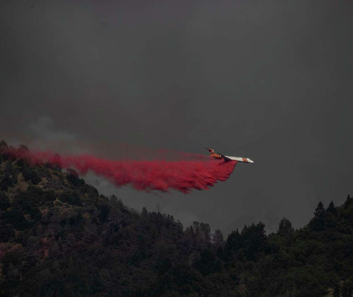A tanker releases flame retardant on the Salt Fire in Lakehead-Lakeshore (Shasta County) over the weekend.