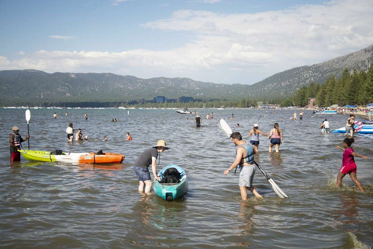 Beaches in South Lake Tahoe see an influx of visitors on July 4, 2021.