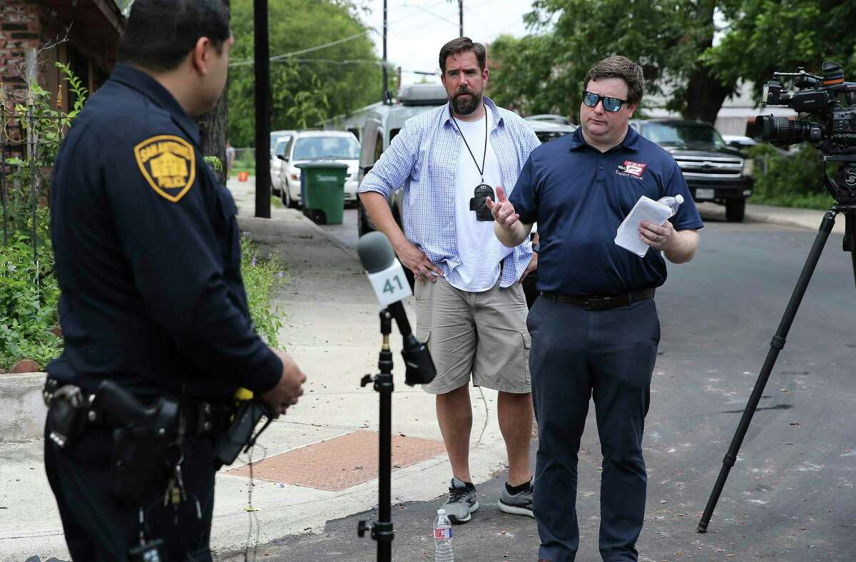 KSAT photographer Josh Saunders (center) and reporter Dillon Collier attend a SAPD news conference where police were involved in a standoff with a man who fired shots at residents and at the KSAT crew on Monday, July 5, 2021.
