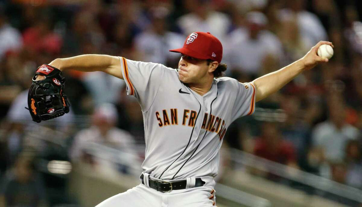 PHOENIX, ARIZONA - JULY 03: Starting pitcher Sammy Long #73 of the San Francisco Giants throws against the Arizona Diamondbacks during the third inning of the MLB game at Chase Field on July 03, 2021 in Phoenix, Arizona. (Photo by Ralph Freso/Getty Images)