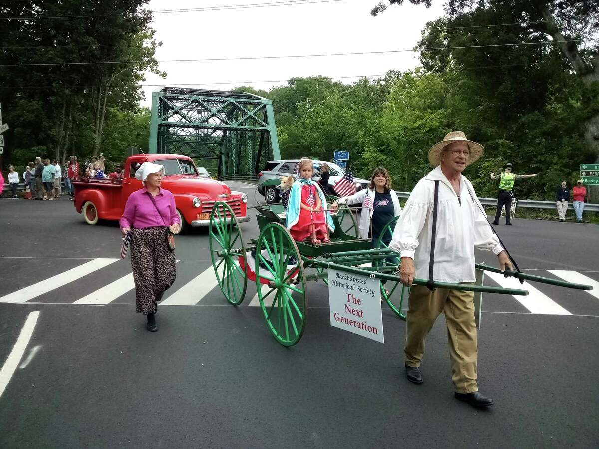 """Barkhamsted held its Independence Day parade Monday, July 5. The Barkhamsted Historical Society featured """"the next generation"""" of members in its wagon."""
