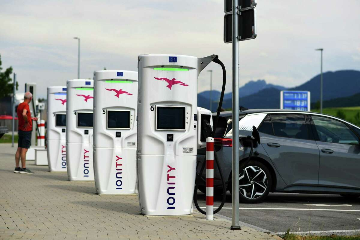 Some oil companies are teaming with transporation companies to expand EV chargers as they seek to lower greenhouse gas emissions.