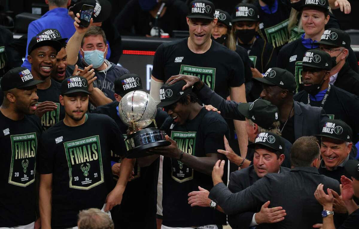 Jrue Holiday, holding the Eastern Conference Finals trophy, and the Bucks are crashing the NBA Finals party along with the Suns.