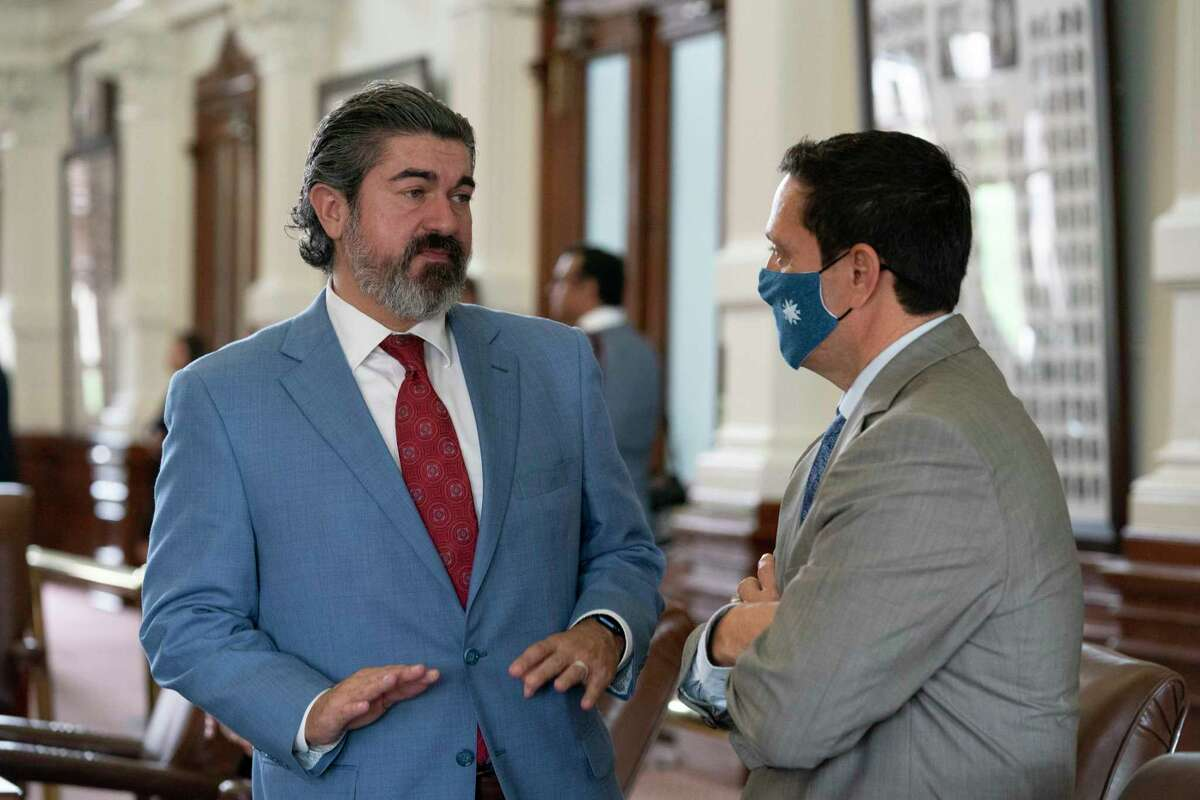 State Rep. Eddie Rodriguez, l, D-Austin, talks with Rep. Trey Martinez-Fischer, D-San Antonio on the final day of the 87th Texas Legislature. Both led Sunday's walkout in the chamber that stalled SB 7 the voting rights bill.