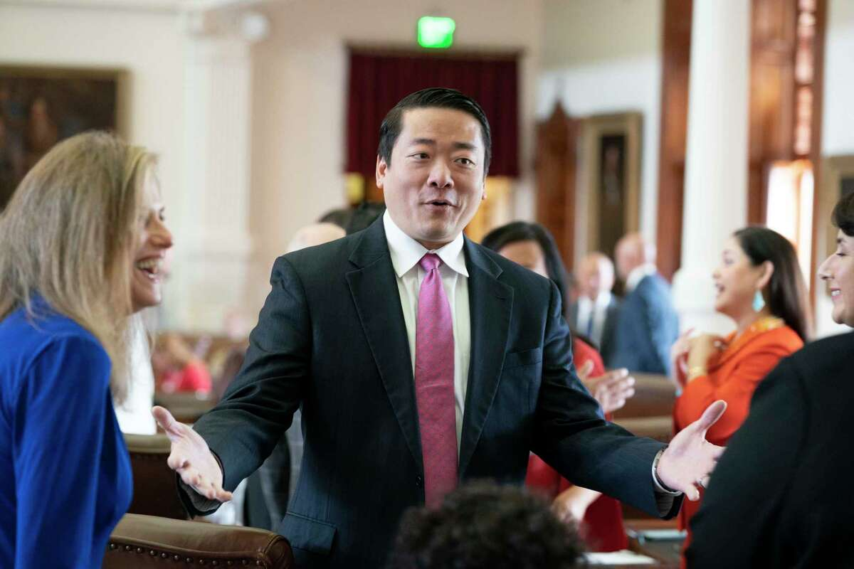 State Rep. Gene Wu, Democrat from Houston, exults in successfully helping kill SB 7 the voter integrity bill with a late night walkout on the final full day of the 87th Texas Legislature. At left is Rep. Donna Howard, D-Austin. (Bob Daemmrich/CapitolPressPhoto)