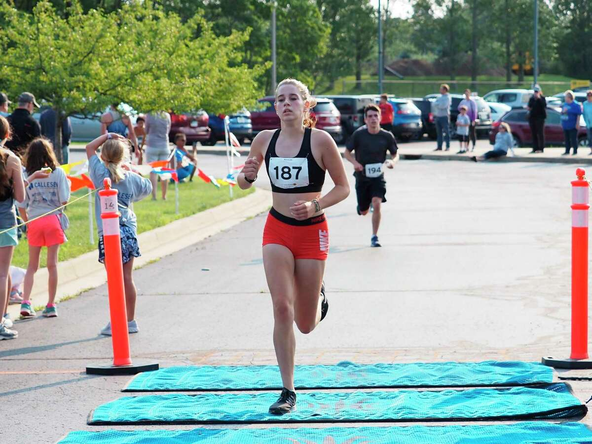 Cecelia Postma races to a top-25 overall finish in Manistee's Firecracker 5K on Saturday. (Courtesy photo/Megan McCarthy)