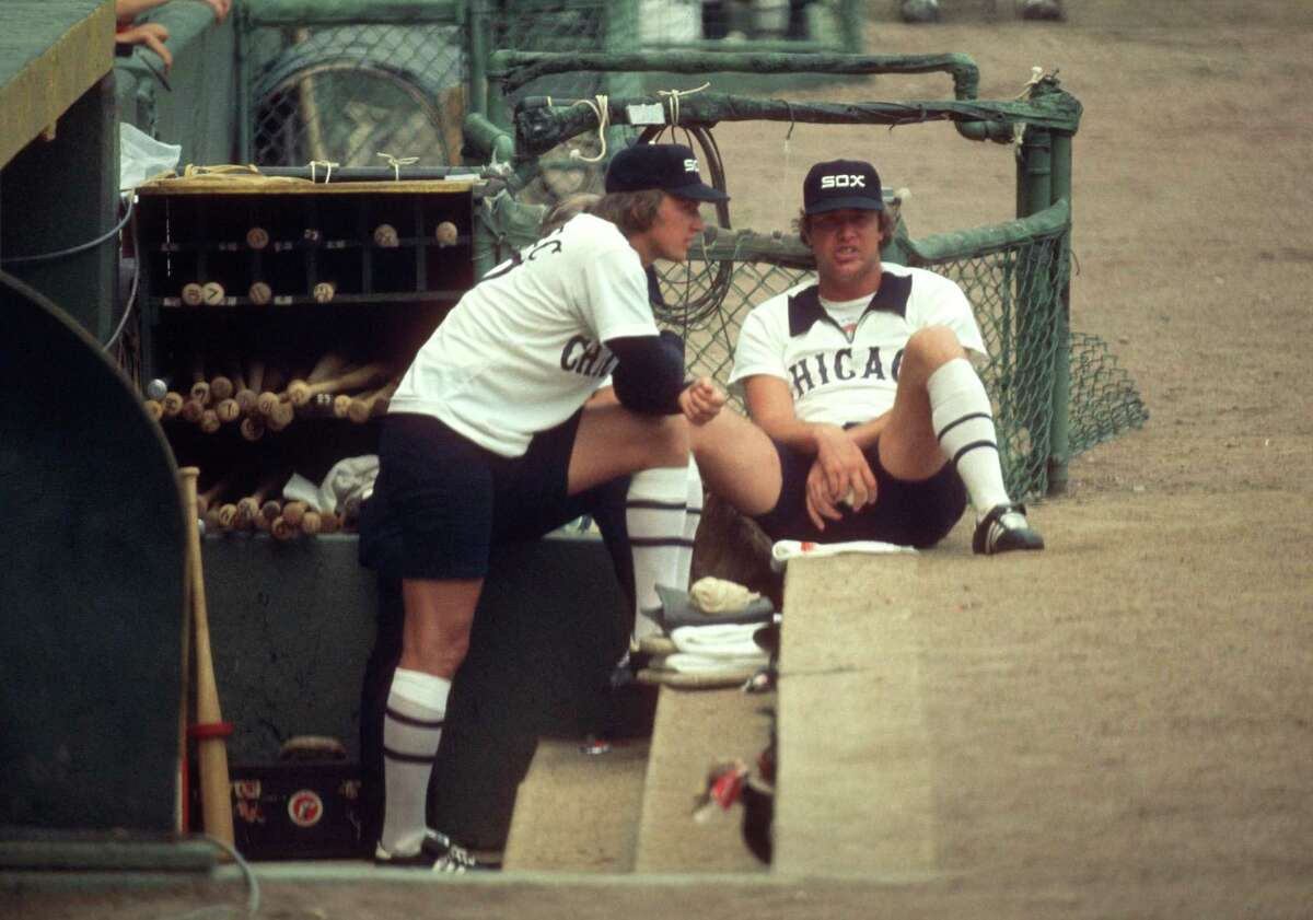 """CHICAGO-08-08-1976: Ken Kravec and Rich """"u201cGoose""""u201d Gossage of the Chicago White Sox look on during a MLB game at Comiskey Park in Chicago, Illinois. This was the first game that shorts were worn during a major league game. Kravec played for the Chicago White Sox from 1975-1980. Gosage played with the Chicago White Sox from 1972-1976. (Photo by Ron Vesely/MLB Photos via Getty Images)"""