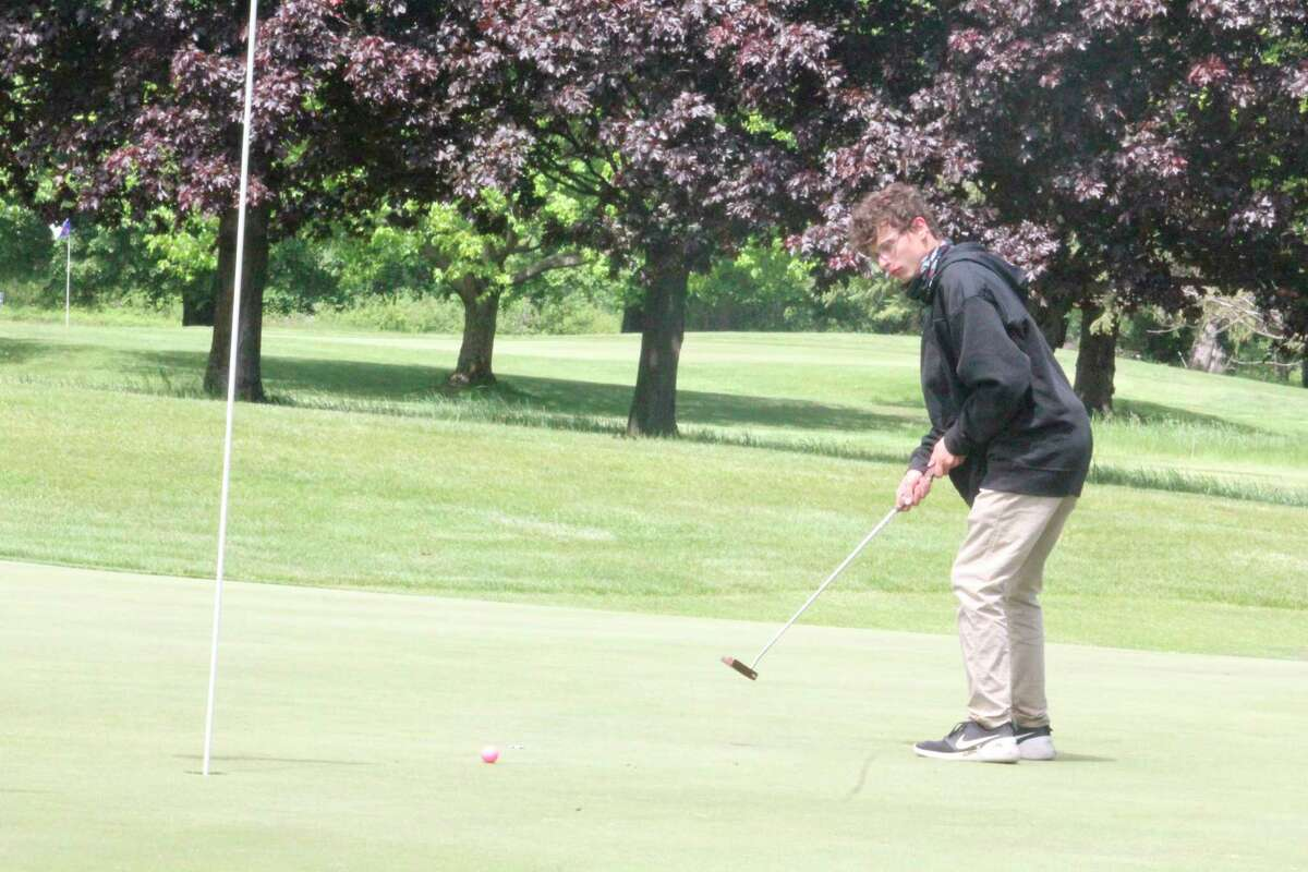 Reed City's Michael Perri watches his putt at Katke Golf Course during the
