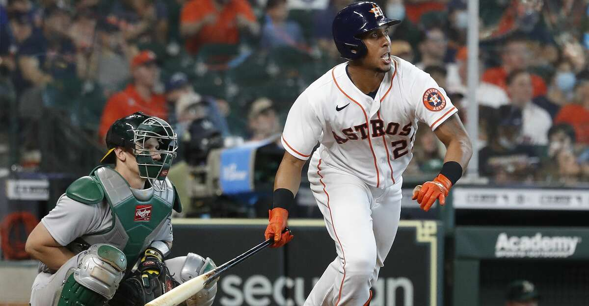 Houston Astros Michael Brantley (23) hits an RBI triple during the seventh inning of an MLB baseball game at Minute Maid Park, in Houston, Saturday, April 10, 2021.